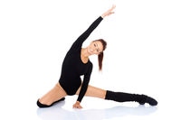 Happy young girl doing stretching