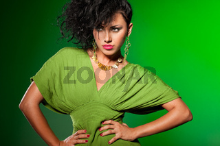 elegant fashionable woman on green