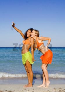 teens having fun with camera on summer holiday