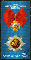 RUSSIA - 2013: shows The Order of Saint Catherine the Great Martyr on the blue background, series State decorations of the Russian Federation