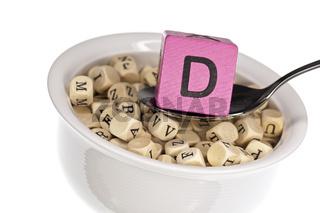 Vitaminreiche Alphabetsuppe zeigt Vitamin D