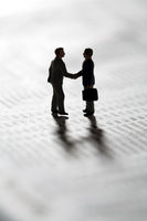Sealing a business transaction with a handshake