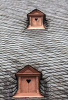 Dormer in a slate roof, shutters with heart, Germany, Europe