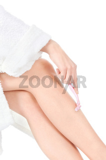 woman shaving her lags