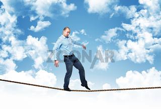 man walk on rope