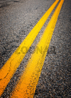 yellow dividing lines on the highway