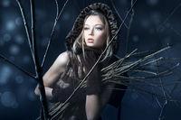 Beautiful woman in magic night forest