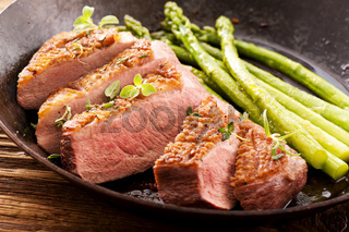 duck breast fillet with green asparagus