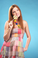Beautiful young woman with lollipop