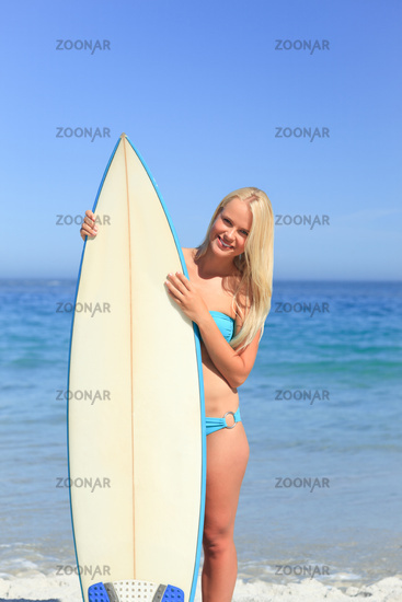 Lovely woman with her surfboard