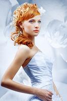 Beautiful girl in wedding dress with creative hair