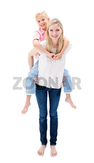 Cute little girl enjoying piggyback ride with her mother