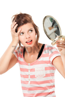 teenage girl  putting on make-up