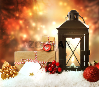 Christmas lantern with ornaments and presents