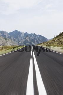 Straight line highway among mountains