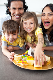 Lively family eating cookies