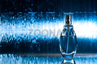 Perfume on blue background