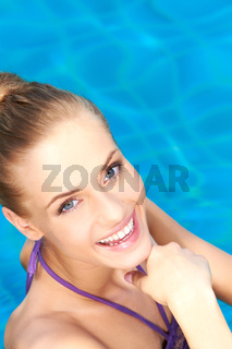 Close up of happy girl in swimming pool