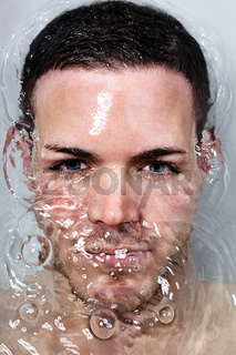 Portrait of a bautiful young man underwater