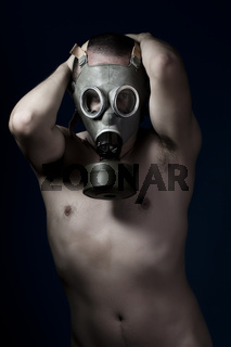 Fear, shirtless man and gas mask