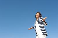 Innocent mature woman sky background