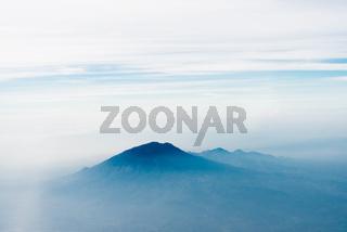Volcano top under sky, bird's eye view.