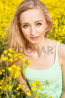 beautiful blonde girl in a field in summer