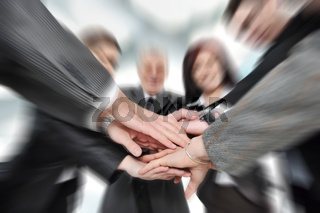 Group of business people with hands together for unity and partnership