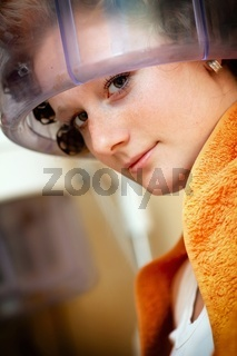 Woman drying hair at the hairdresser