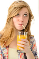Dreamy blonde girl sipping orange juice