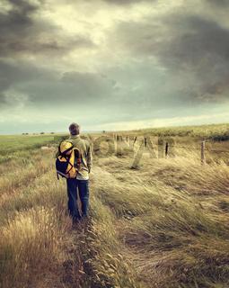 Man walking down country road