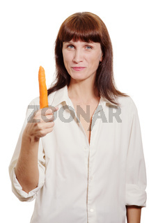 woman showing fresh carrot