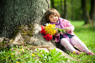 little beautiful girl with flowers