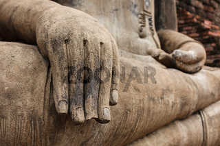 Buddha statue hand close up detail. Sukhothai