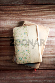 Aged books on a rustic wooden table
