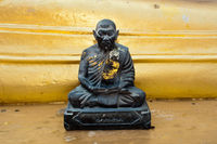 Black monk statue in Wat Phra Yai Temple. Thailand