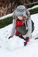 Teenager girl making snowman