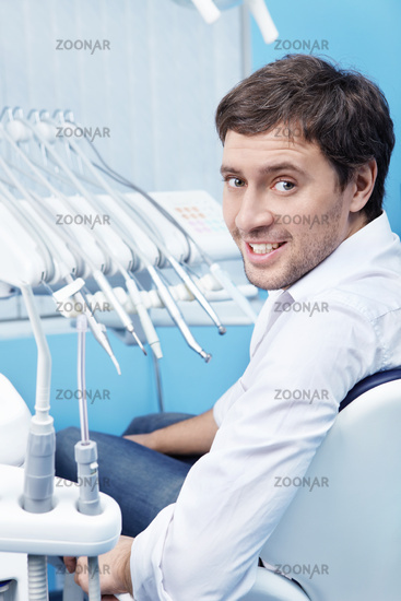 Attractive young man in dentistry