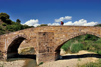 Spain: Pilgrim crossing Salado bridge