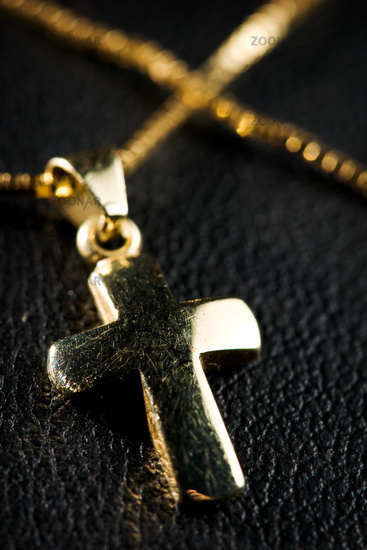 golden jewelry cross