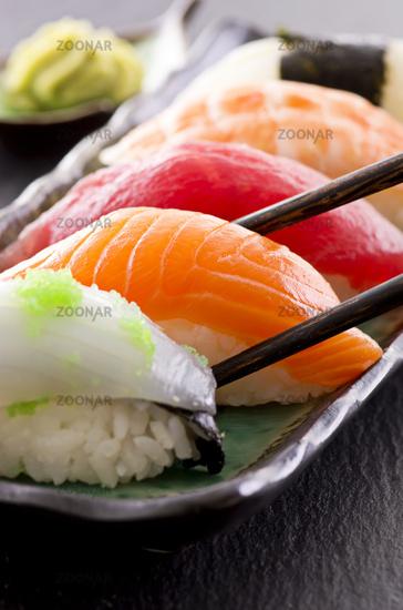 sushi with chop sticks