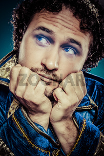 Blue prince dressed with elegant prussian blue jacket, melancholy and sadness