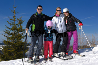 portrait of happy young family at winter