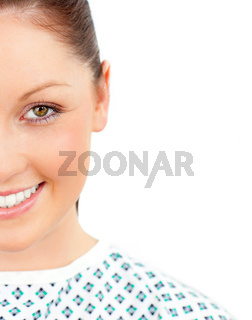 Close-up of a smiling female patient looking at the camera against a white background