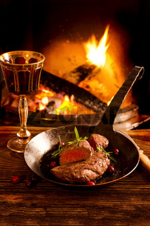 steak in the pan with wine