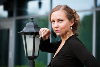 Beautiful woman at lamppost