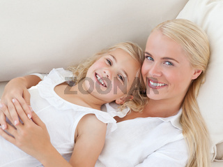 Beautiful woman lying down with her daughter