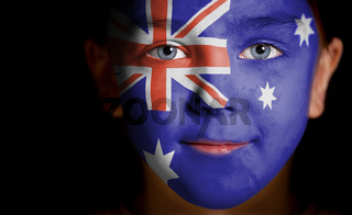 Portrait of a child with a painted Australian flag