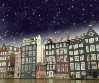Amsterdam. Beautiful view of classic buildings with night sky