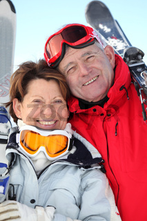 Smiling man and woman in ski resort